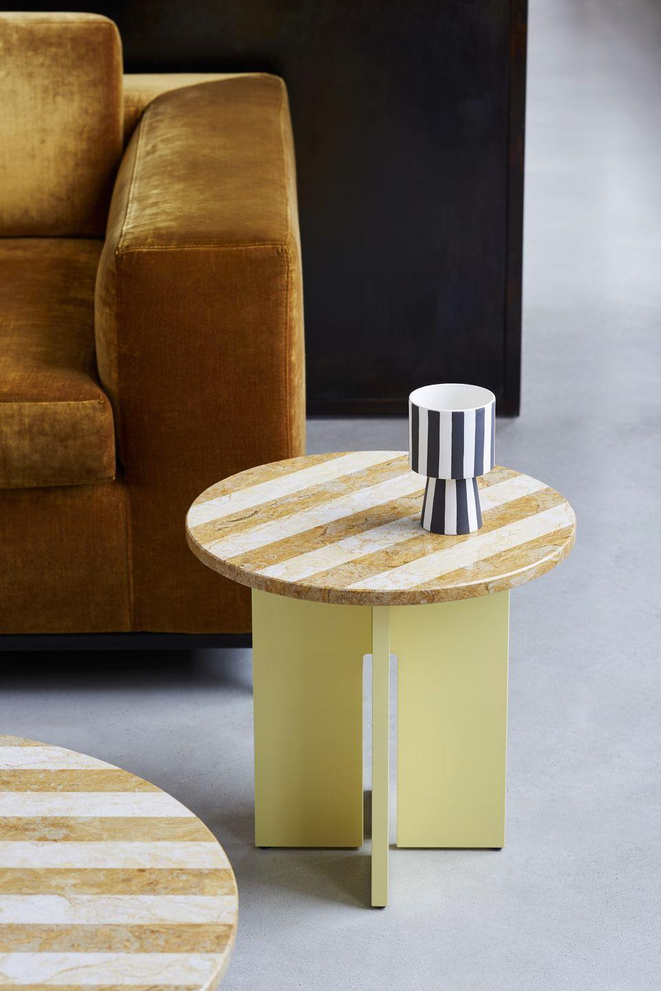 """<p>The 'Sediment' side tables by Hamburg-based design agency Studio Besau-Marguerre appear to be made from two different types of marble. But look closer and you'll see the tops are crafted from single slabs of stone, with the striped pattern created by alternating honed and polished finishes. From £930, <a href=""""https://www.favius.de"""" rel=""""nofollow noopener"""" target=""""_blank"""" data-ylk=""""slk:favius.de"""" class=""""link rapid-noclick-resp"""">favius.de</a></p>"""