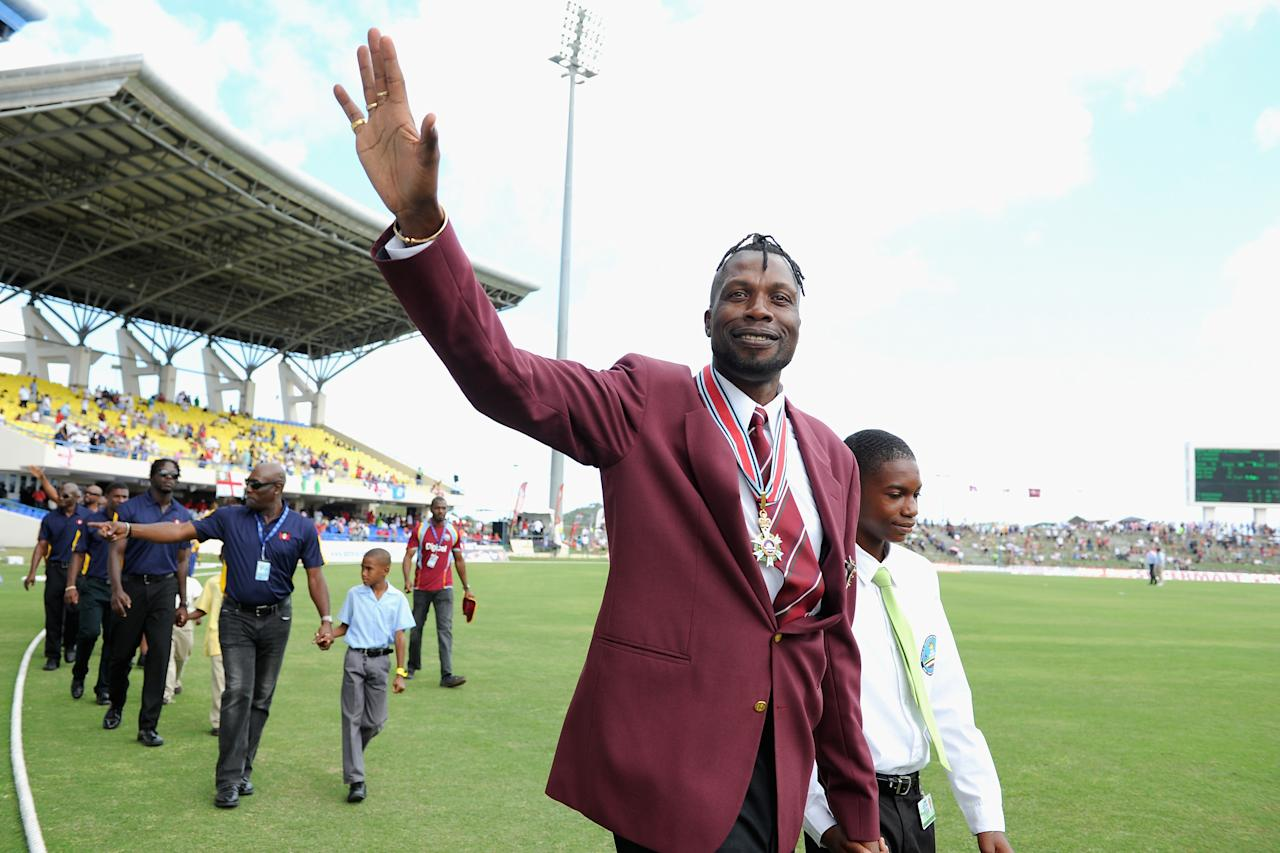 ANTIGUA, ANTIGUA AND BARBUDA - FEBRUARY 28:  Former West Indian cricketer Curtly Ambrose is paraded round the field after being awarded his knighthood during the lunch break of the 1st One Day International between West Indies and England at Sir Viv Richards Cricket Ground on February 28, 2014 in Antigua, Antigua and Barbuda.  (Photo by Gareth Copley/Getty Images)