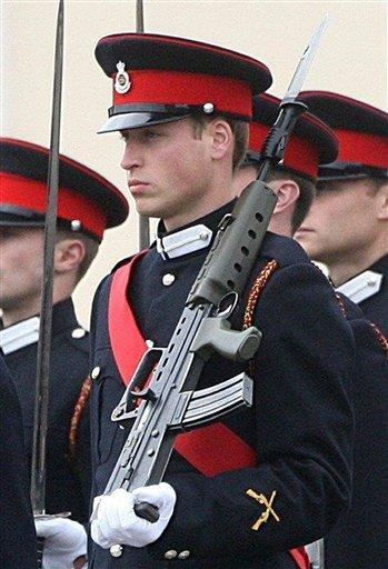 Prince William marches with other Sandhurst Military Academy graduates in the Sovereign's parade Friday Dec. 15, 2006. Major General Sebastian Roberts, the general officer commanding the Household Division, who is ultimately William's new boss as he joins the Blues and Royals, said Friday that a deployment to a conflict zone for Prince William could not be ruled in or out.(AP Photo/Lewis Whyld, Pool)