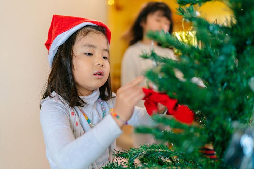 """<p>Most people put up their Christmas tree before the big day arrives, but decorating with your guests can create some beautiful memories. Put up a tabletop version and grab extra ornaments to trim the tree together or keep the kids occupied while the adults cook the roast beast.</p><p><a class=""""link rapid-noclick-resp"""" href=""""https://www.amazon.com/s?k=tabletop+christmas+trees&ref=nb_sb_noss_2&tag=syn-yahoo-20&ascsubtag=%5Bartid%7C10055.g.29777938%5Bsrc%7Cyahoo-us"""" rel=""""nofollow noopener"""" target=""""_blank"""" data-ylk=""""slk:Shop Tabletop Trees"""">Shop Tabletop Trees</a></p>"""