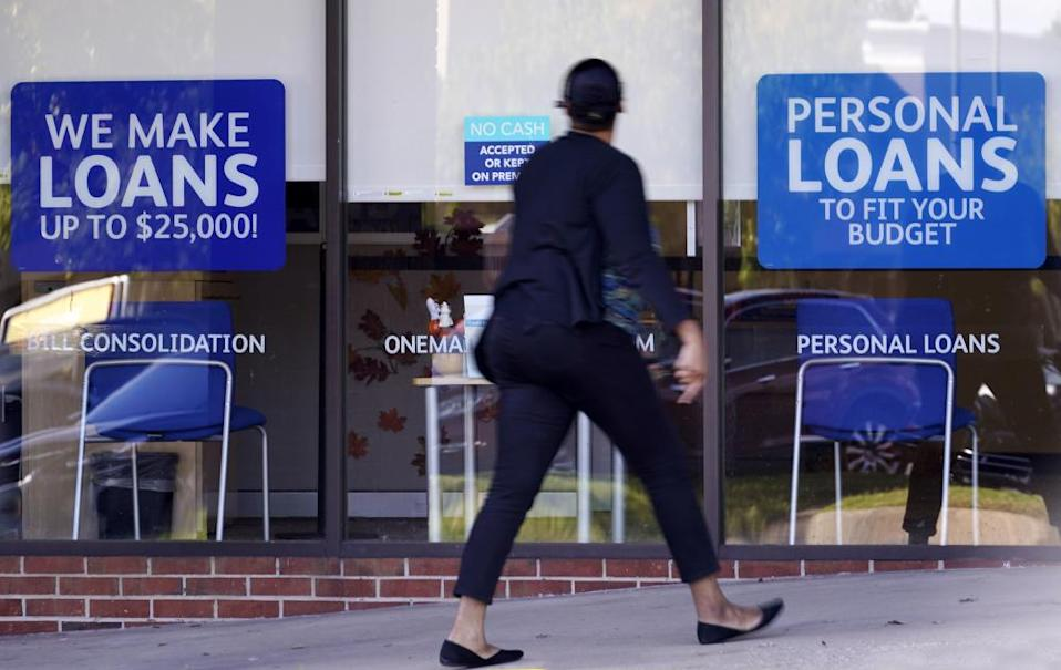 A woman walks past a personal finance loan office on 1 October in Franklin, Tennessee.