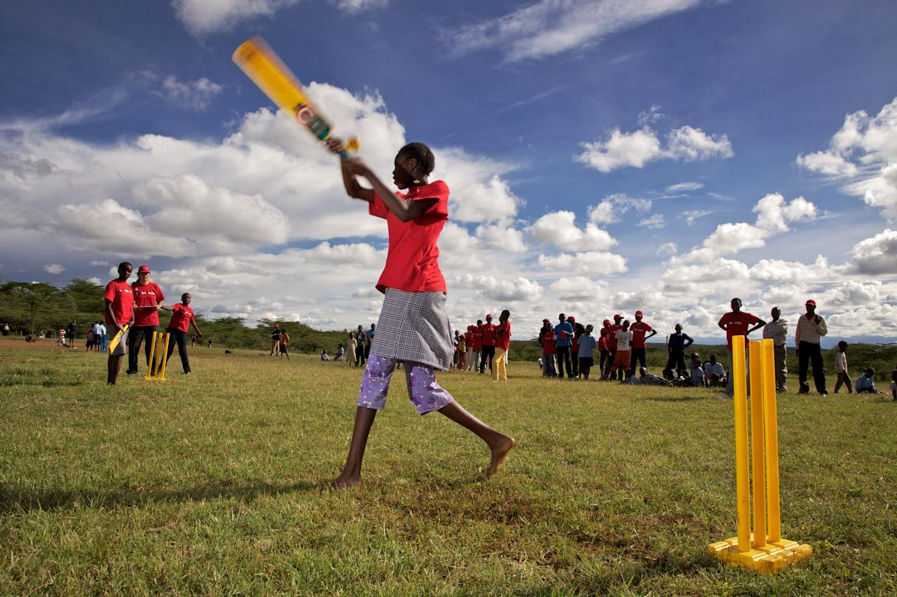 LAIKIPIA, KENYA - NOVEMBER 25:  Young girls take the opportunity to play cricket on November 25, 2011 in Laikipia, Kenya. Members of the Maasai Cricket Warriors team in Kenya helped support the ICC's Think Wise awareness campaign, ahead of World Aids Day, which is celebrated across the globe on 1 December, by delivering HIV prevention messages to children in Kenya. The Maasai Cricket Warriors have been trained to become Level One cricket coaches. As well as providing technical support to players, they also deliver important social messages such as HIV prevention. They are one of the most unique cricket teams in the world. They helped support the ICC's Think Wise HIV partnership by delivering prevention messages ahead of World Aids Day. The Think Wise campaign, a partnership between the ICC, UNAIDS and UNICEF, helps deliver HIV prevention messages through cricket.  (Photo by Getty Images for the ICC)
