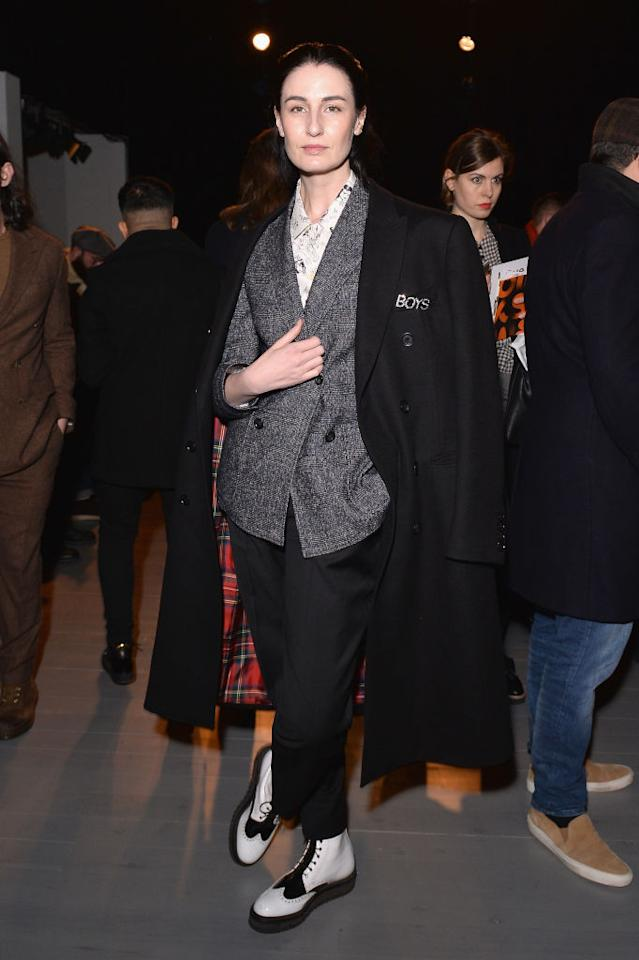 <p>Model Erin O'Connor borrowed from the boys this season and rocked up to the Oliver Spencer show in a double-breasted blazer and brogues. She finished the look with a coat draped across her shoulders. One word, chic. <em>[Photo: Getty]</em> </p>