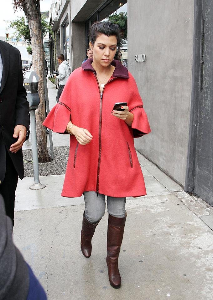 Kourtney's baby bump is beginning to show! The pregnant 32-year-old was adorable in an ensemble featuring a Tibi coat, Bluelab jeans, and Michael Kors boots. (2/15/2012)