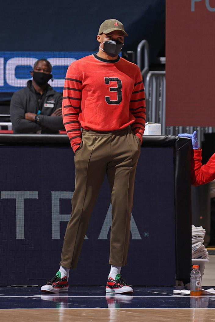 Russell Westbrook of the Wizards watches a game against the Phoenix Suns in Washington, D.C., January 11, 2021.