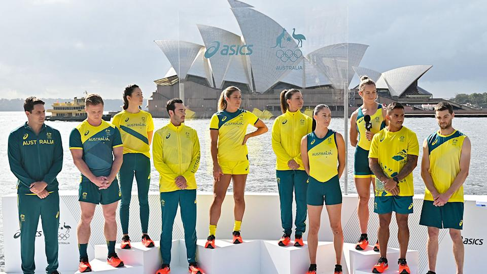 Some of Australia's Olympic Games athletes show off the new uniforms during a March unveiling.