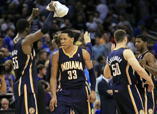 Indiana Pacers players, including from left, Roy Hibbert (55), Danny Granger (33), and Tyler Hansbrough (50) celebrate an overtime win against the Orlando Magic 101-99 in Game 4 of an NBA first-round playoff basketball series, Saturday, May 5, 2012, in Orlando, Fla.(AP Photo/John Raoux)