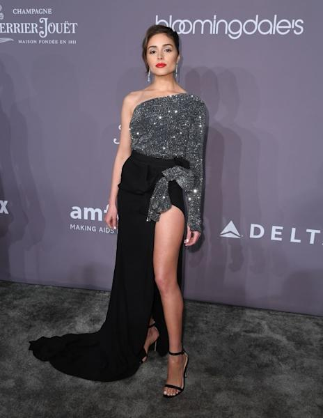 Olivia Culpo dazzled at the amfAR gala in an asymmetric dress by Redemption with a seductive split and glittery details shimmering in the light. New York, February 7, 2018