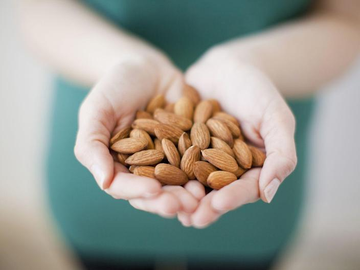 """<p>To avoid feeling weak or hungry, try snacking on dry-roasted almonds or walnuts. """"A one-ounce serving of <a href=""""https://www.prevention.com/food-nutrition/a20502781/walnut-recipes/"""" rel=""""nofollow noopener"""" target=""""_blank"""" data-ylk=""""slk:walnuts"""" class=""""link rapid-noclick-resp"""">walnuts</a>, <a href=""""https://www.prevention.com/food-nutrition/a20500859/health-benefits-of-almonds/"""" rel=""""nofollow noopener"""" target=""""_blank"""" data-ylk=""""slk:almonds"""" class=""""link rapid-noclick-resp"""">almonds</a>, or other nut gives you satiety for hours thanks to the combination of protein, fiber, and healthy fats,"""" says Williams. """"In fact, a <a href=""""https://nutrition.bmj.com/content/early/2019/08/27/bmjnph-2019-000034"""" rel=""""nofollow noopener"""" target=""""_blank"""" data-ylk=""""slk:2019 study"""" class=""""link rapid-noclick-resp"""">2019 study</a> suggested that individuals who eat a small serving of nuts are more likely to have lower body weights and less likely to gain weight.""""</p>"""