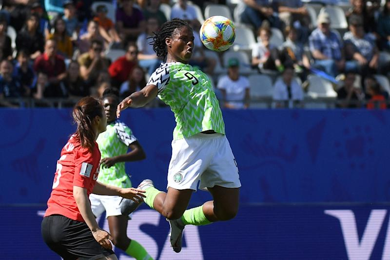 Desire Oparanozie (R) in action for Nigeria at the women's World Cup. She plays in France so Monday's clash with the hosts will be a particularly special occasion for her