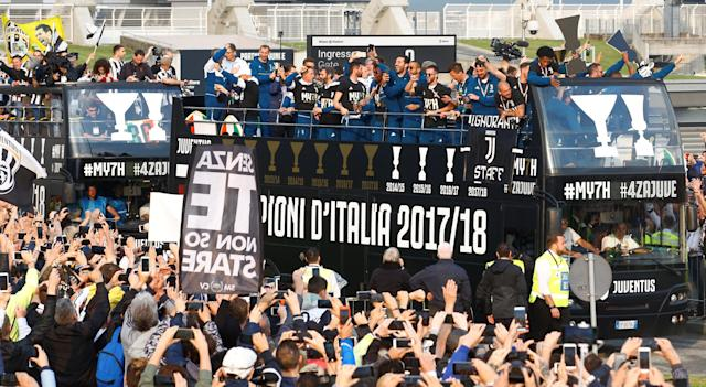 Soccer Football - Serie A - Juventus vs Hellas Verona - Allianz Stadium, Turin, Italy - May 19, 2018 General view of the Juventus players celebrating winning the league on open top buses after the match REUTERS/Stefano Rellandini