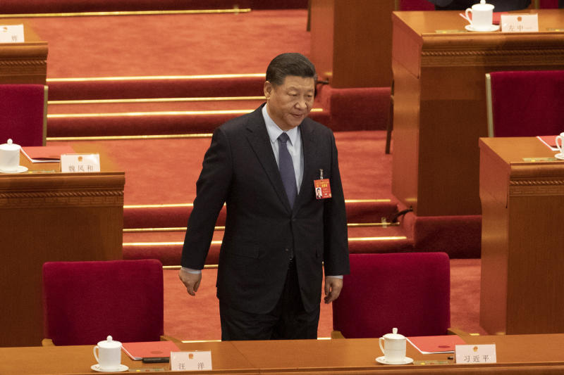 Chinese President Xi Jinping arrives for the closing session of the National People's Congress in Beijing's Great hall of the People on Friday, March 15, 2019. (AP Photo/Ng Han Guan)
