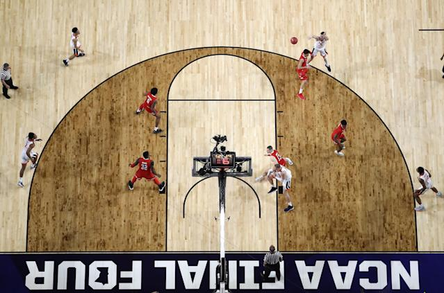 The Virginia Cavaliers handle the ball on offense against the Texas Tech Red Raiders in the first half during the 2019 NCAA men's Final Four National Championship game at U.S. Bank Stadium on April 08, 2019 in Minneapolis, Minnesota. (Photo by Streeter Lecka/Getty Images)