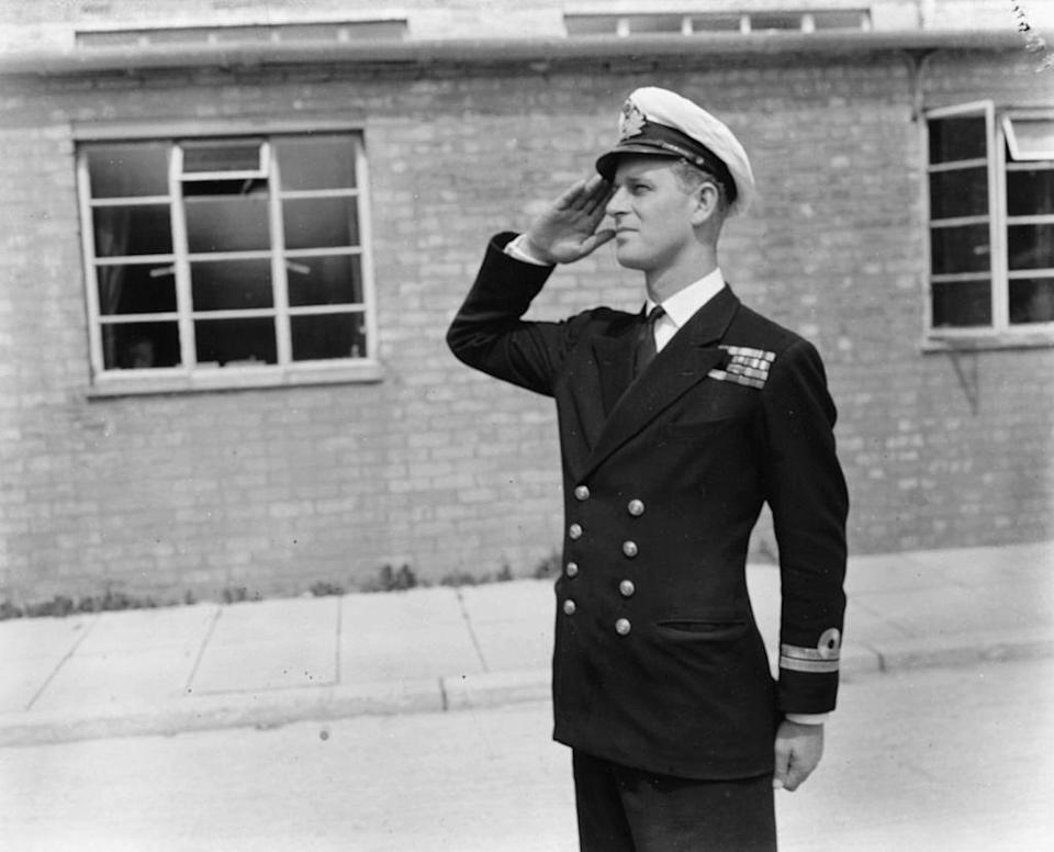 <p>Lieutenant Philip Mountbatten, prior to his marriage to Princess Elizabeth, saluting as he resumes his attendance at the Royal Naval Officers School in Dartmouth, England.</p>