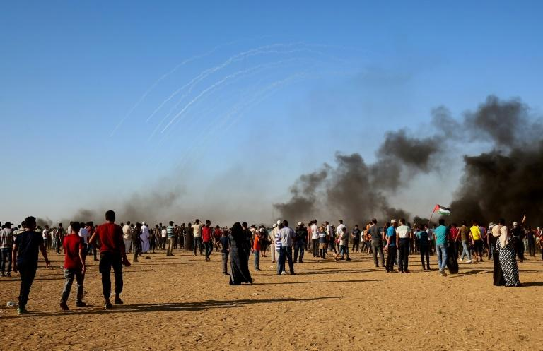 Protesters gather at the Israeli border in the southern Gaza Strip, where Israeli fire on August 10, 2018 left three Palestinians dead