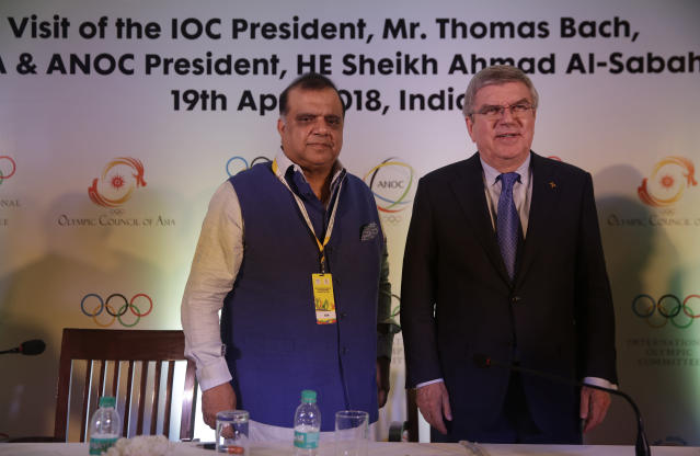 President Indian Olympic Association Narinder Dhruv Batra attend a press conference with International Olympic Committee (IOC) President Thomas Bach in New Delhi, India, Thursday, April 19, 2018. During his two-day long stay, Bach is scheduled to meet Indian Sports Minister Rajyavardhan Rathore and newly elected Indian Olympic Association office bearers. (AP Photo/Altaf Qadri)