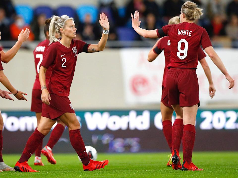 Rachel Daly high-fives teammates during England's match against Luxembourg.