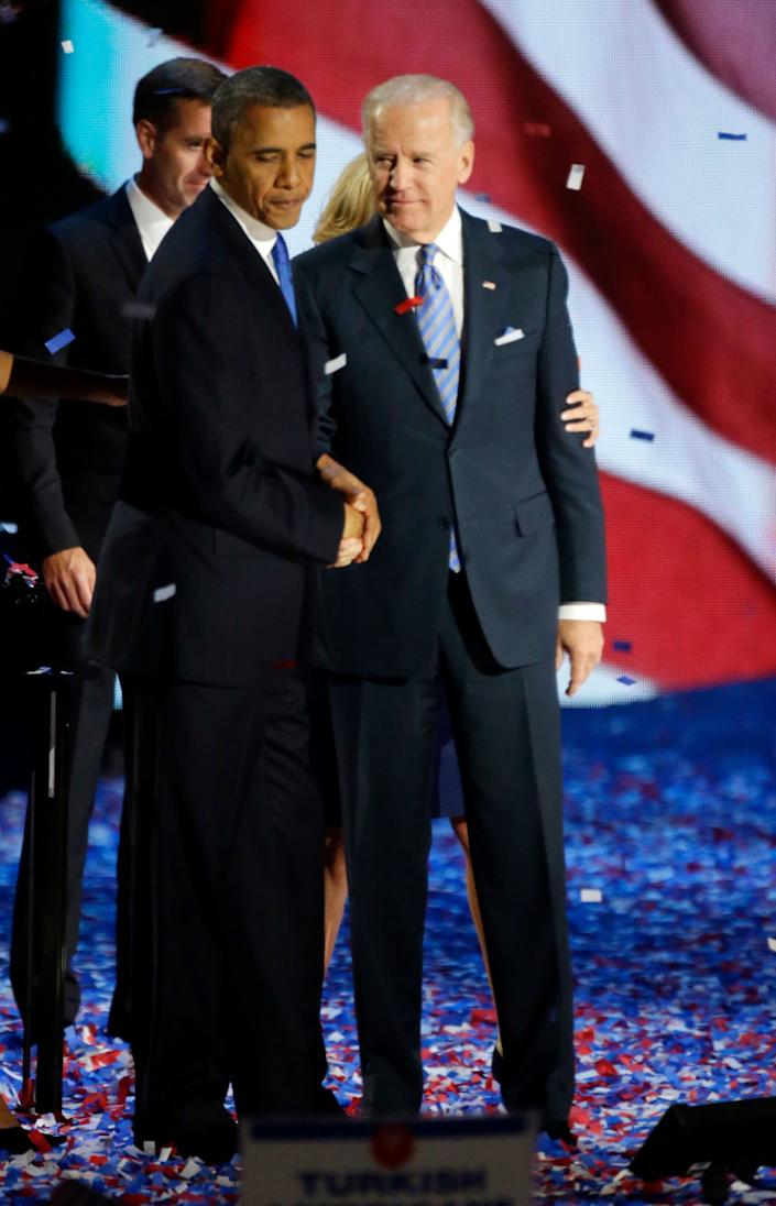 President Barack Obama and Vice President Joe Biden shake hands after President's speech at his election night party Wednesday, Nov. 7, 2012, in Chicago. President Obama defeated Republican challenger former Massachusetts Gov. Mitt Romney. (AP Photo/Pablo Martinez Monsivais)