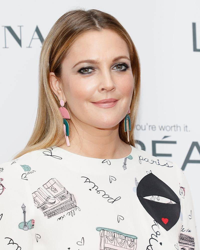 Drew barrymore unleashes her best smolder in new mascara ad flowers look delicate but theyre tough just like drew barrymores warrior look and video for flower beautys new mascara to mark the release of her izmirmasajfo Images