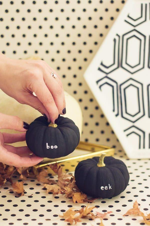 "<p>Make your tiny pumpkins even cuter by painting them black and writing spooky sayings on them with a <a href=""https://www.amazon.com/gp/product/B0013JTI00/?tag=syn-yahoo-20&ascsubtag=%5Bartid%7C10055.g.1714%5Bsrc%7Cyahoo-us"" rel=""nofollow noopener"" target=""_blank"" data-ylk=""slk:paint pen"" class=""link rapid-noclick-resp"">paint pen</a>. </p><p><em><a href=""https://lovelyindeed.com/diy-tiny-message-pumpkins/"" rel=""nofollow noopener"" target=""_blank"" data-ylk=""slk:Get the tutorial at Lovely Indeed »"" class=""link rapid-noclick-resp"">Get the tutorial at Lovely Indeed »</a></em></p>"