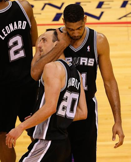 Tim Duncan hugs ferociously. (Tom Pennington/Getty Images)