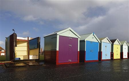 A beach hut has been overturned by strong winds during storms that battered Britain at Brighton in south east England October 28, 2013. REUTERS/Luke MacGregor