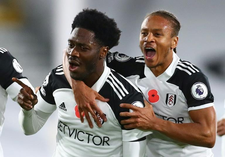 Fulham's Ola Aina (L) celebrates scoring against West Brom
