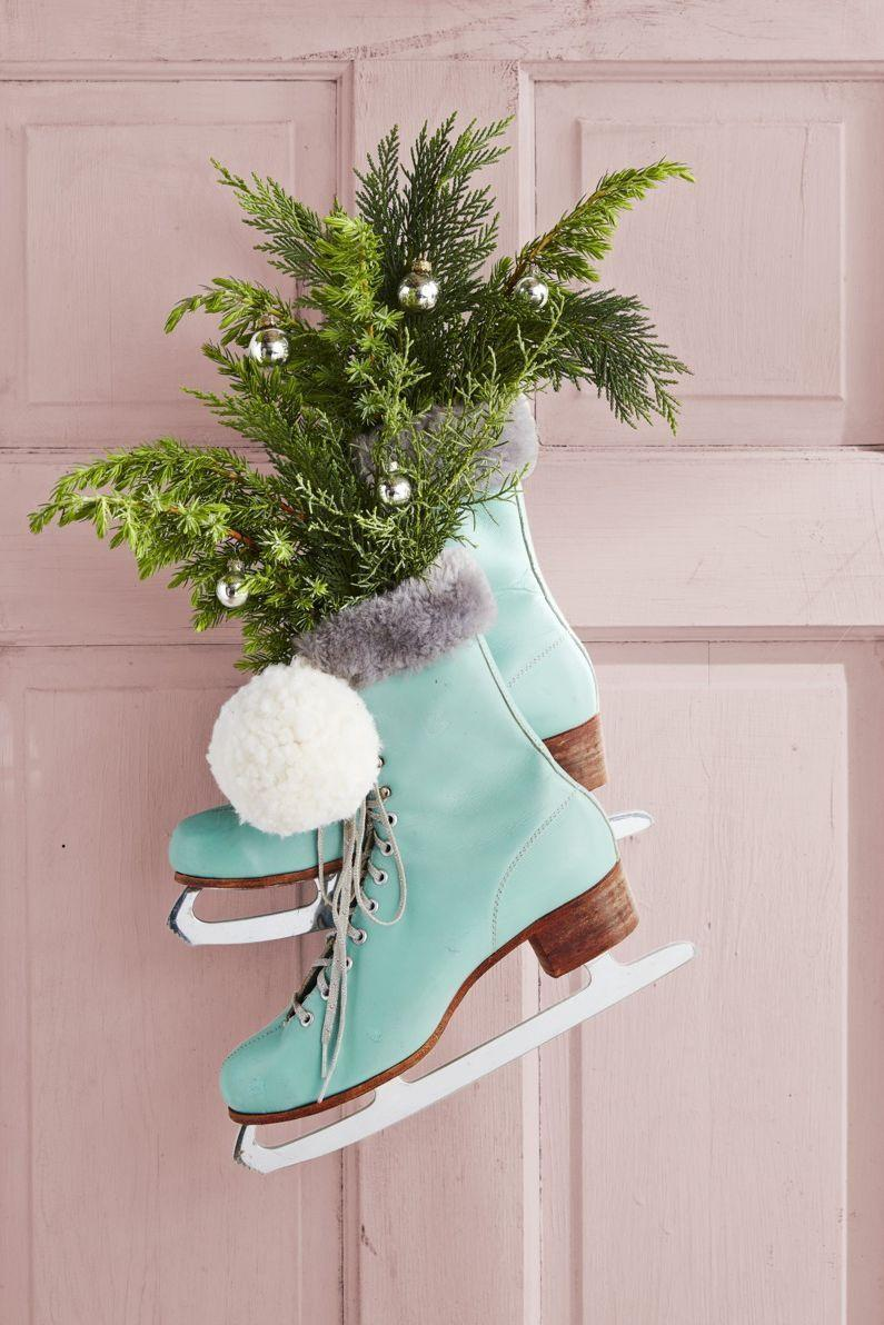 """<p>Ditch the traditional wreath for one featuring fur-lined ice skates filled with greenery. Dress them up with pom-poms and silver ornaments to make even more of an impact.</p><p><strong>RELATED:</strong> <a href=""""https://www.goodhousekeeping.com/holidays/christmas-ideas/how-to/g1253/diy-christmas-wreaths/"""" rel=""""nofollow noopener"""" target=""""_blank"""" data-ylk=""""slk:60 Christmas Wreath Ideas for a Jolly Holiday"""" class=""""link rapid-noclick-resp"""">60 Christmas Wreath Ideas for a Jolly Holiday</a></p>"""