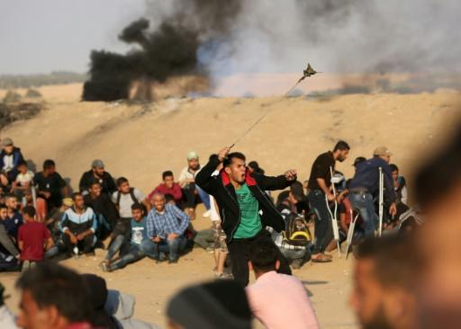 Palestinians protestors gather on Gaza's border with Israel as sporadic clashes flare with Israeli forces on May 15, 2018