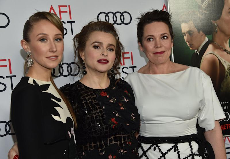 Dohery (left), Bonham Carter and Colman work the red carpet as a team (AFP via Getty Images)