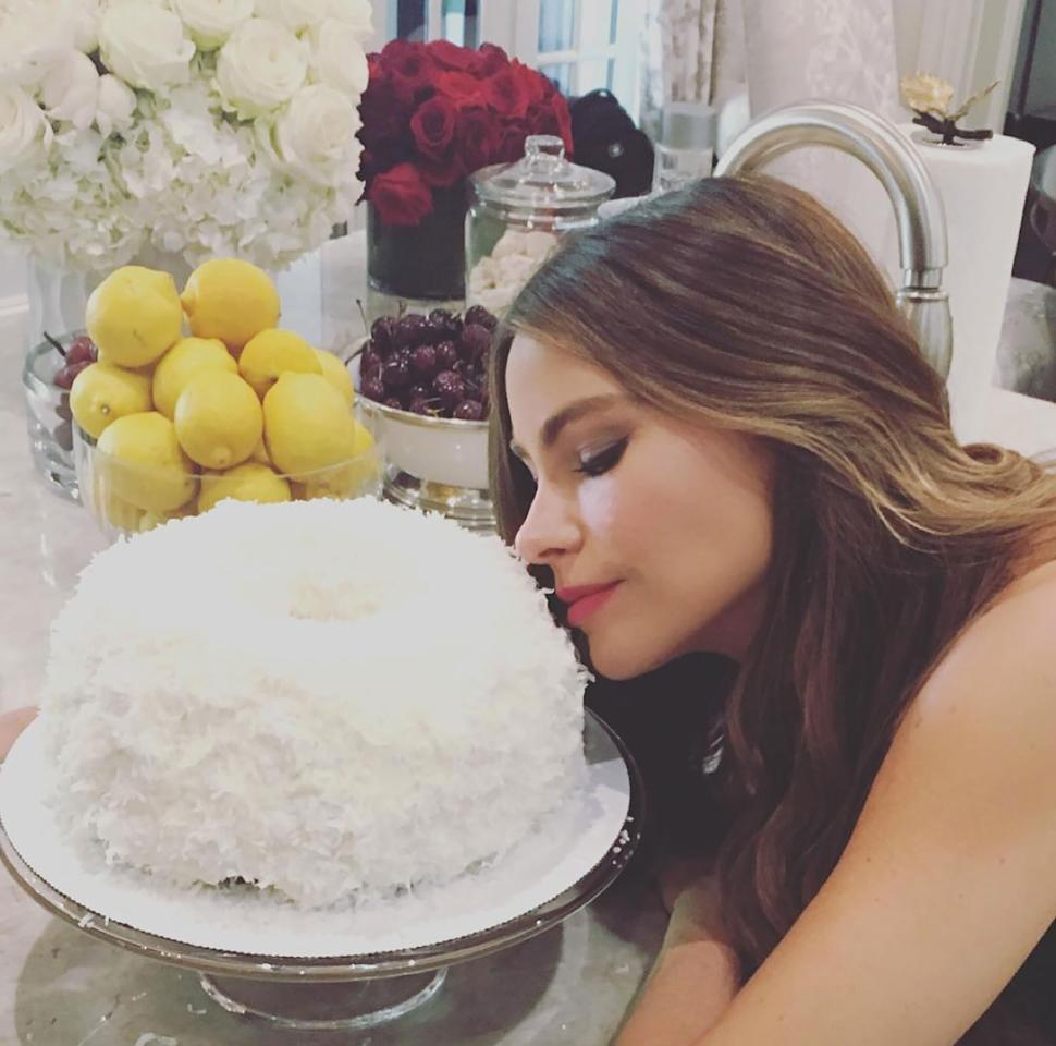 """""""Stop tempting me with this happy bday cake,"""" the <i>Modern Family</i> star writes, tagging co-star Eric Stonestreet in a <a href=""""https://www.instagram.com/p/BHnn_ryh4xa/?taken-by=sofiavergara"""" target=""""_blank"""">pic showcasing the 44-year-old actress</a> getting acquainted with her sweet coconut confection."""