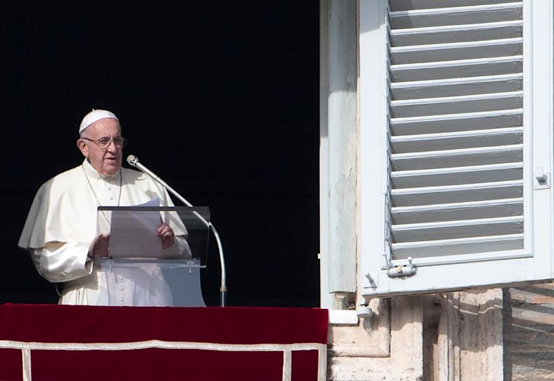 Pope Francis addresses the crowd from the window of the apostolic palace overlooking Saint Peter's square during his Sunday Angelus prayer on Dec. 2. (Photo: TIZIANA FABI via Getty Images)