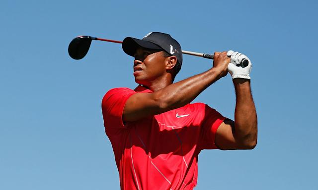 ATLANTA, GA - SEPTEMBER 23: Tiger Woods watches his tee shot on the seventh hole during the final round of the TOUR Championship by Coca-Cola at East Lake Golf Club on September 23, 2012 in Atlanta, Georgia. (Photo by Kevin C. Cox/Getty Images)