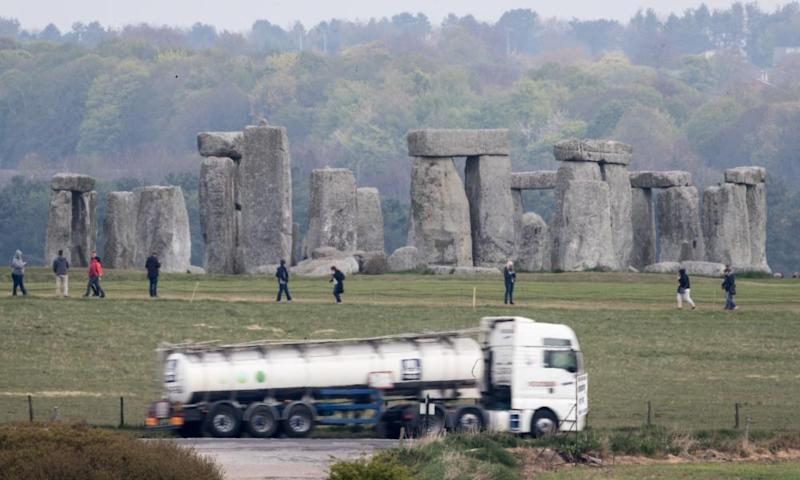 Traffic passes along the A303 next to Stonehenge