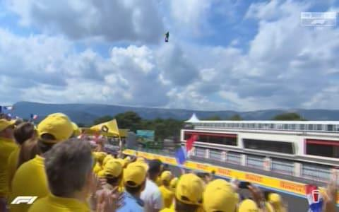 A man on a hoverboard above the track - Credit: SKY SPORTS F1