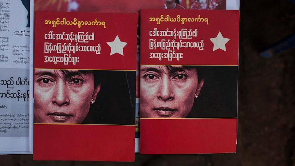 Booklets bearing Aung San Suu Kyi`s face in Myanmar after her party swept to victory in November 2015`s election