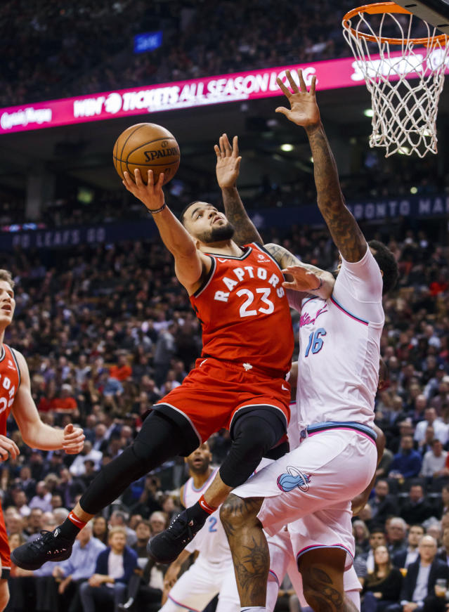 Toronto Raptors' guard Fred VanVleet goes to the basket against Miami Heat forward James Johnson, right, during the first half of an NBA basketball game, Tuesday, Feb. 13, 2018, in Toronto. (Mark Blinch/The Canadian Press via AP)