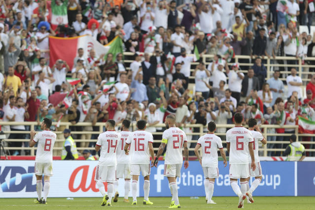 Iranian players applaud fans at the end of the AFC Asian Cup group D soccer match between Iran and Vietnam at Al Nahyan Stadium in Abu Dhabi, United Arab Emirates, Saturday, Jan. 12, 2019. Iran won 2-0. (AP Photo/Kamran Jebreili)