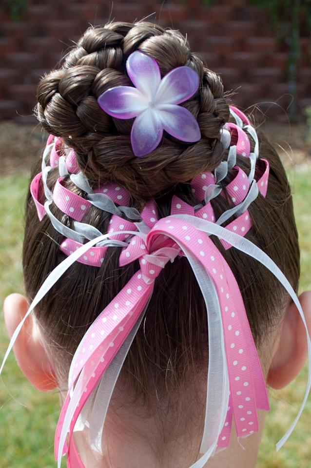 "<p>Use pretty ribbons in various colors and prints to create this woven style resembling an Easter basket. </p><p><strong>Get the tutorial at <a rel=""nofollow"" href=""http://princesspiggies.blogspot.com/2011/04/easter-basket-bun.html"">Princess Piggies</a>.</strong></p>"