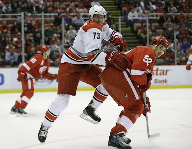 Carolina Hurricanes defenseman Brett Bellemore (73) and Detroit Red Wings defenseman Jonathan Ericsson (52) of Sweden wait on the puck during the first period of an NHL hockey game in Detroit, Thursday, Nov. 21, 2013. (AP Photo/Carlos Osorio)