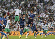 Saudi Arabia's Mohamed Kanno, top left, and Japan's Yuya Osako, fight for the ball with Saudi Arabia's Sultan Al-Ghannam during the Asian zone group B qualifying soccer match for the FIFA World Cup Qatar 2022 at the King Abdullah sports city stadium, in Jiddah, Saudi Arabia, Thursday, Oct. 7, 2021. (AP Photo)