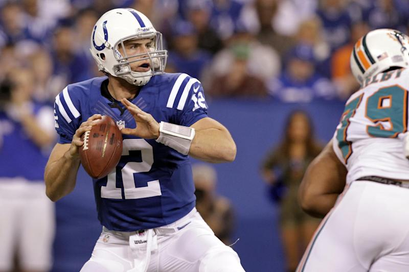 Indianapolis Colts quarterback Andrew Luck (12) throws against the Miami Dolphins during the first half of an NFL football game in Indianapolis, Sunday, Nov. 4, 2012. Luck threw for 433 yards and two touchdown passes, breaking Carolina Panthers quarterback Cam Newton's single-game passing record (422 yards) for a rookie as he led the Colts to a 23-20 win. (AP Photo/AJ Mast)