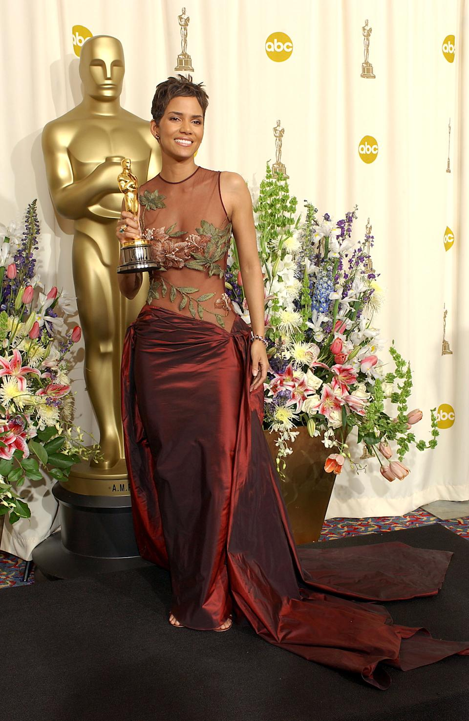 """<p>Berry became the first woman of colour to take home the Best Actress for her role in the gritty drama """"Monster's Ball."""" The history-making win, while wearing the strategically embroidered mesh gown, skyrocketed Elie Saab to international fame, putting the Lebanese designer on the map as the go-to brand for head-turning couture.</p>"""