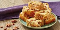 """<p>All your favourite <a href=""""https://www.delish.com/uk/cooking/recipes/a28826709/carrot-cake-banana-bread-recipe/"""" rel=""""nofollow noopener"""" target=""""_blank"""" data-ylk=""""slk:carrot cake"""" class=""""link rapid-noclick-resp"""">carrot cake</a> flavours transformed into one delectable <a href=""""https://www.delish.com/uk/cooking/recipes/a30713621/reeses-peanut-butter-blondies-recipe/"""" rel=""""nofollow noopener"""" target=""""_blank"""" data-ylk=""""slk:blondie"""" class=""""link rapid-noclick-resp"""">blondie</a> complete with cream cheese swirl! If you're a carrot cake purist, you can leave out the walnuts and sultanas.</p><p>Get the <a href=""""https://www.delish.com/uk/cooking/recipes/a31190492/carrot-cake-blondies/"""" rel=""""nofollow noopener"""" target=""""_blank"""" data-ylk=""""slk:Carrot Cake Blondies"""" class=""""link rapid-noclick-resp"""">Carrot Cake Blondies</a> recipe. </p>"""