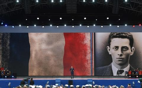 French President Emmanuel Macron stands and speaks during an event to commemorate the 75th anniversary of the D-Day landings - Credit: Daniel Leal-Olivas/AFP