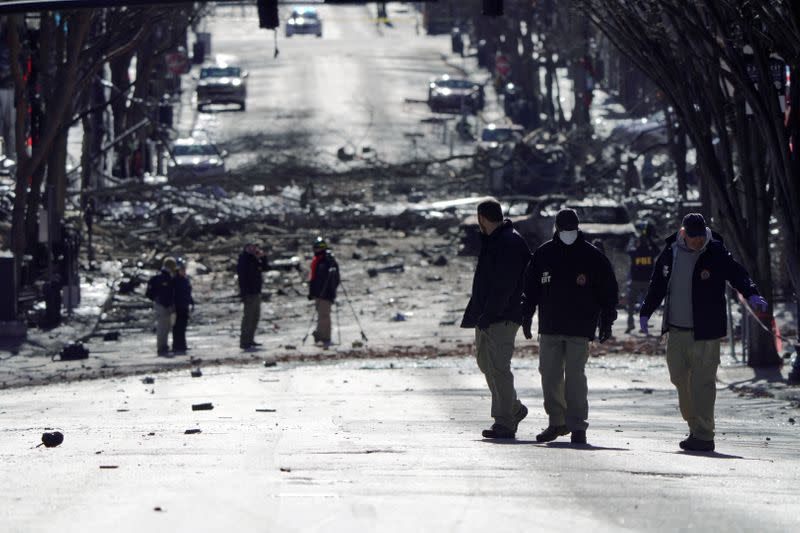 FILE PHOTO: Investigators work near the site of an explosion on 2nd Avenue that occurred the day before in Nashville