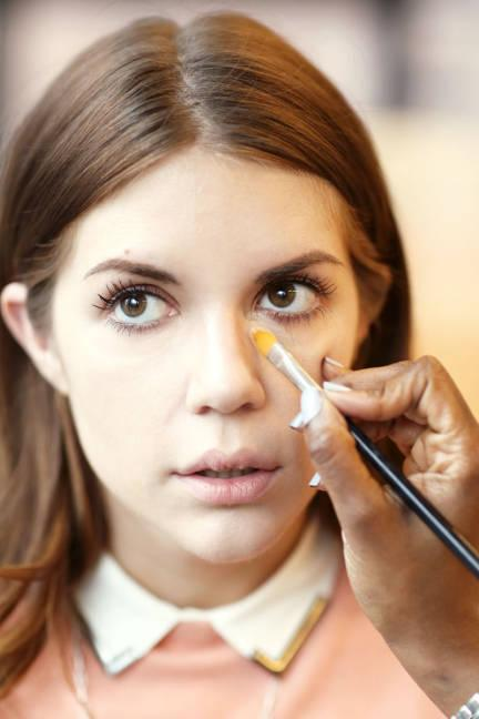 """<div class=""""caption-credit""""> Photo by: Elizabeth Griffin</div><div class=""""caption-title"""">Cover Up</div>""""I recommend a little bit of foundation under the eyes before applying concealer. Women tend to use too much concealer,"""" says Uzo, """"so let the foundation even you out first, then use the concealer if you need it."""" <br> <b><br> More:</b> <b><br></b> <b><a rel=""""nofollow"""" href=""""http://www.elle.com/beauty/makeup-skin-care/best-face-wash#slide-1?link=emb&dom=yah_life&src=syn&con=blog_elle&mag=elm"""" target=""""_blank"""">Best 14 Face Washes Right Now</a></b> <br> <b><a rel=""""nofollow"""" href=""""http://www.elle.com/beauty/makeup-skin-care/naeem-khan-fall-2013-hair-and-makeup?link=emb&dom=yah_life&src=syn&con=blog_elle&mag=elm"""">Naeem Khan's '20s Inspired Hair and Makeup</a></b>"""