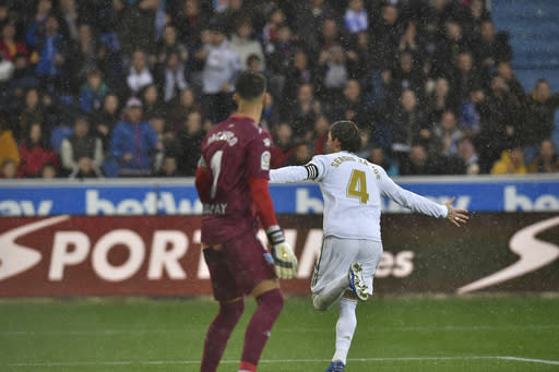 Real Madrid's Real Madrid's Sergio Ramos celebrates his goal after scoring during the Spanish La Liga soccer match between Real Madrid and Alaves at Mendizorroza stadium, in Vitoria, northern Spain, Saturday, Nov. 30, 2019. (AP Photo/Alvaro Barrientos)