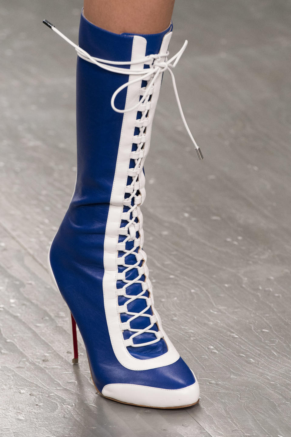 <p><i>Blue-and-white lace-up boots from the SS18 David Koma collection. (Photo: ImaxTree) </i></p>