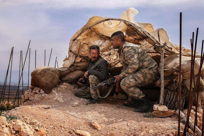 Kurdish fighters survey the area from an elevation near the town of Azaz on the Syrian-Turkish border in 2016. (Photo: Valery Sharifulin/TASS via Getty Images)